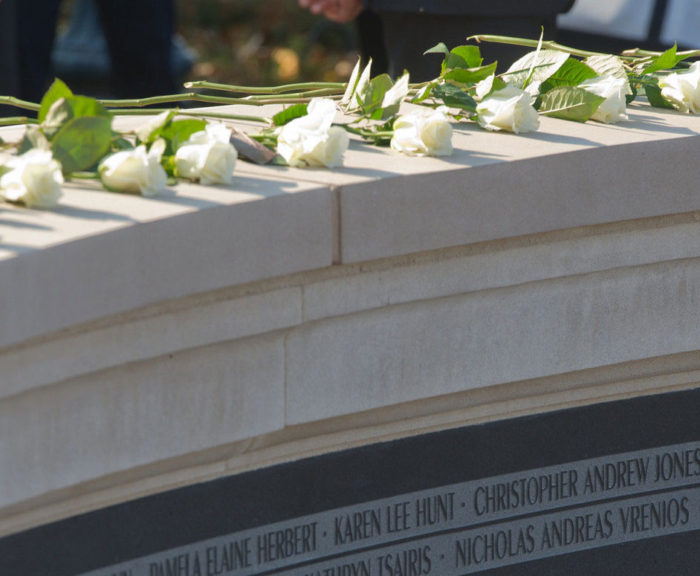 White roses on Wall of Remembrance